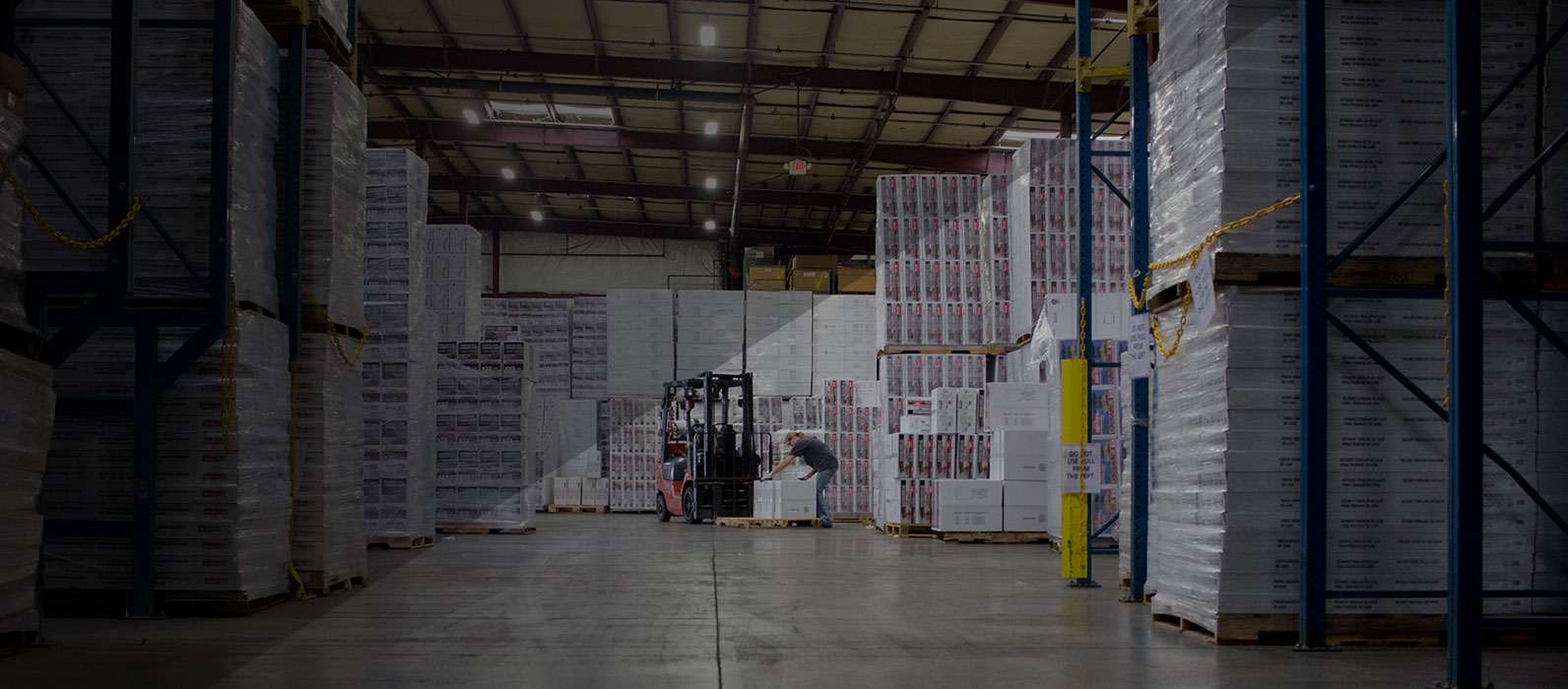 warehouse workers moving a pallet