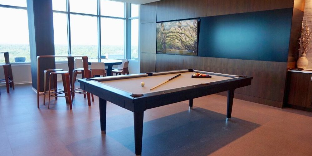 a nice room with a billiards table